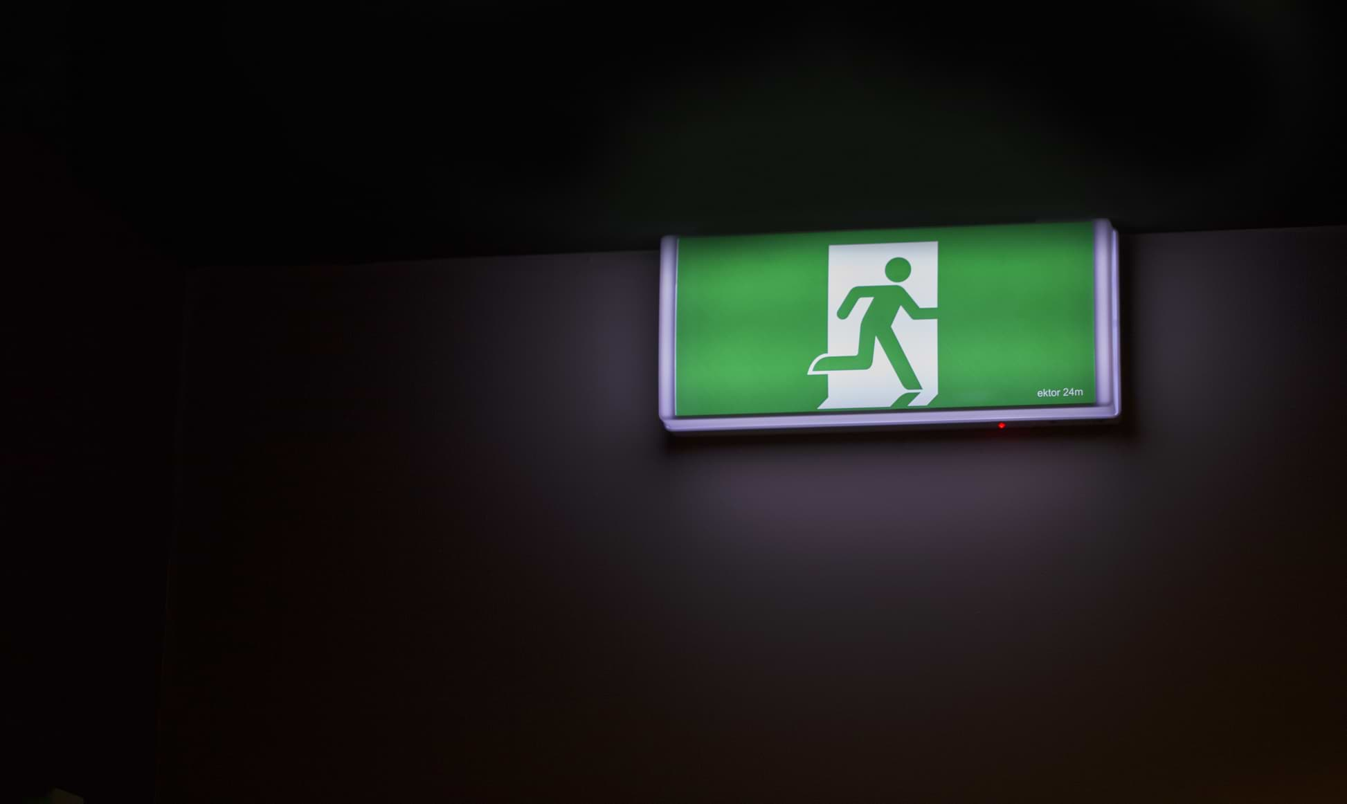 emergency light sign in a dark room